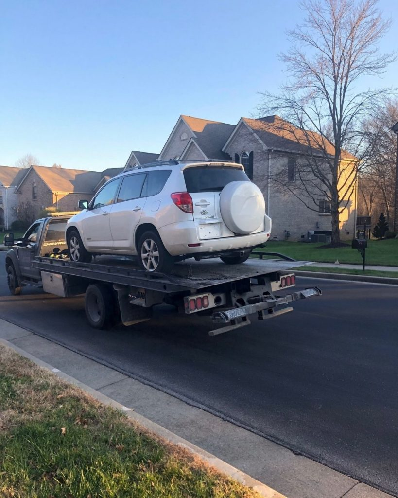 Image of vehicle being towed by auction company.